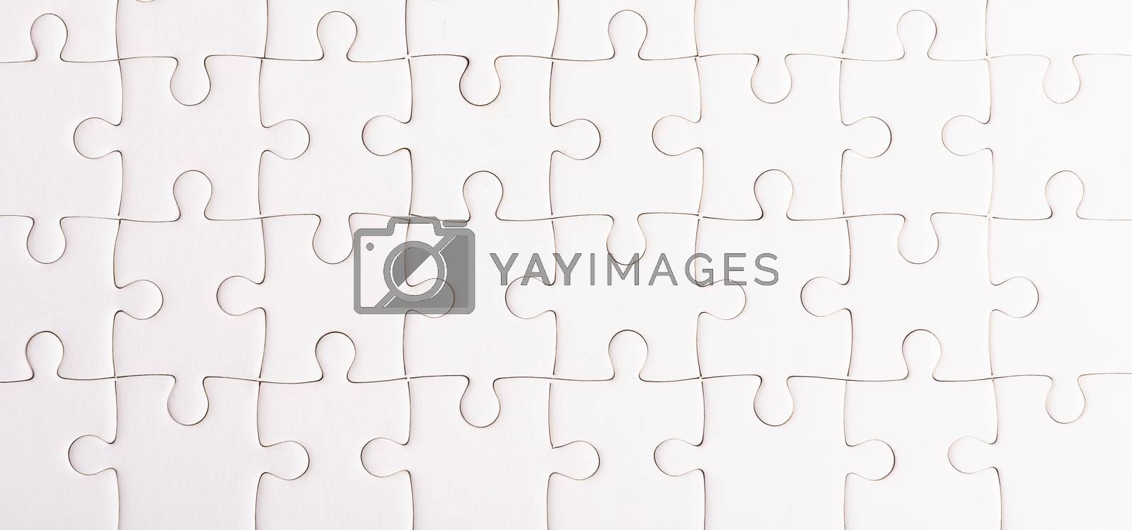Top view flat lay of paper plain full white jigsaw puzzle game texture background, quiz calculation concept