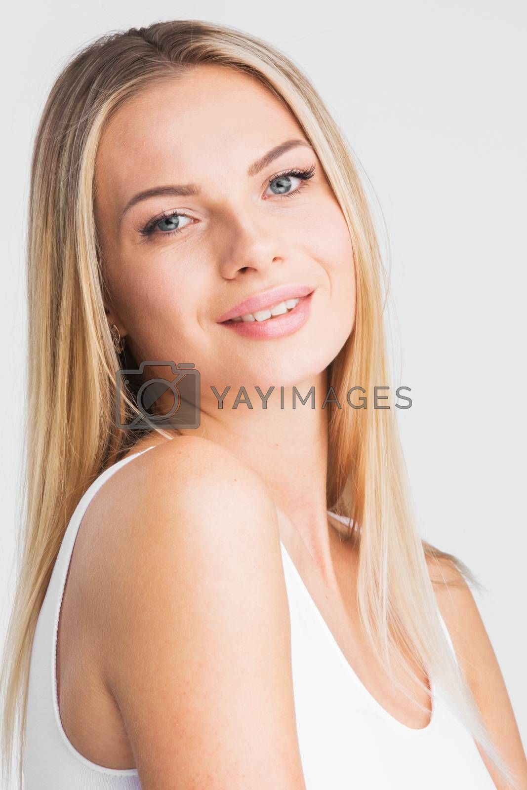 Beautiful smiling woman with long straight hair on a white background beauty skincare concept