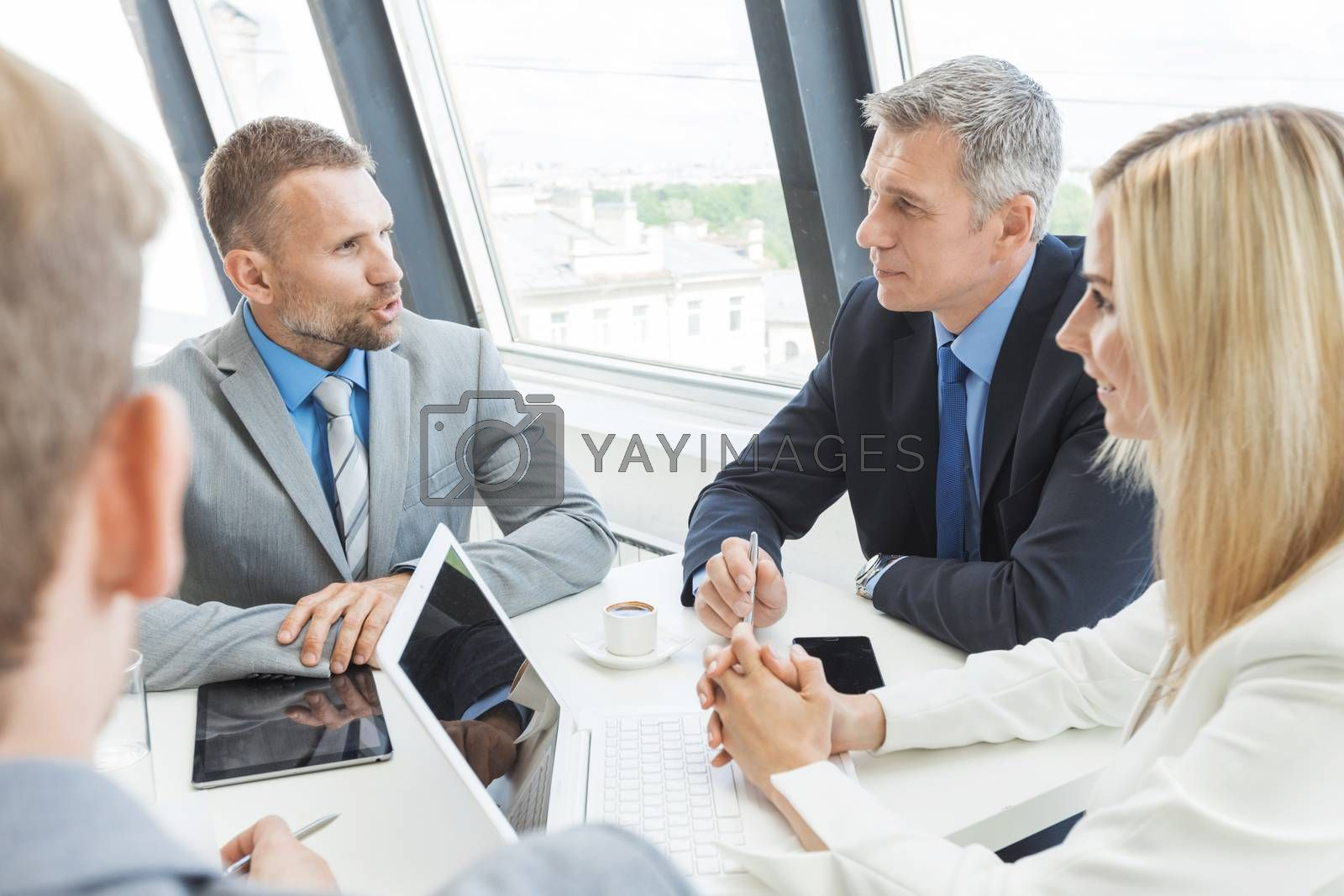 Team of business people talking at meeting in office