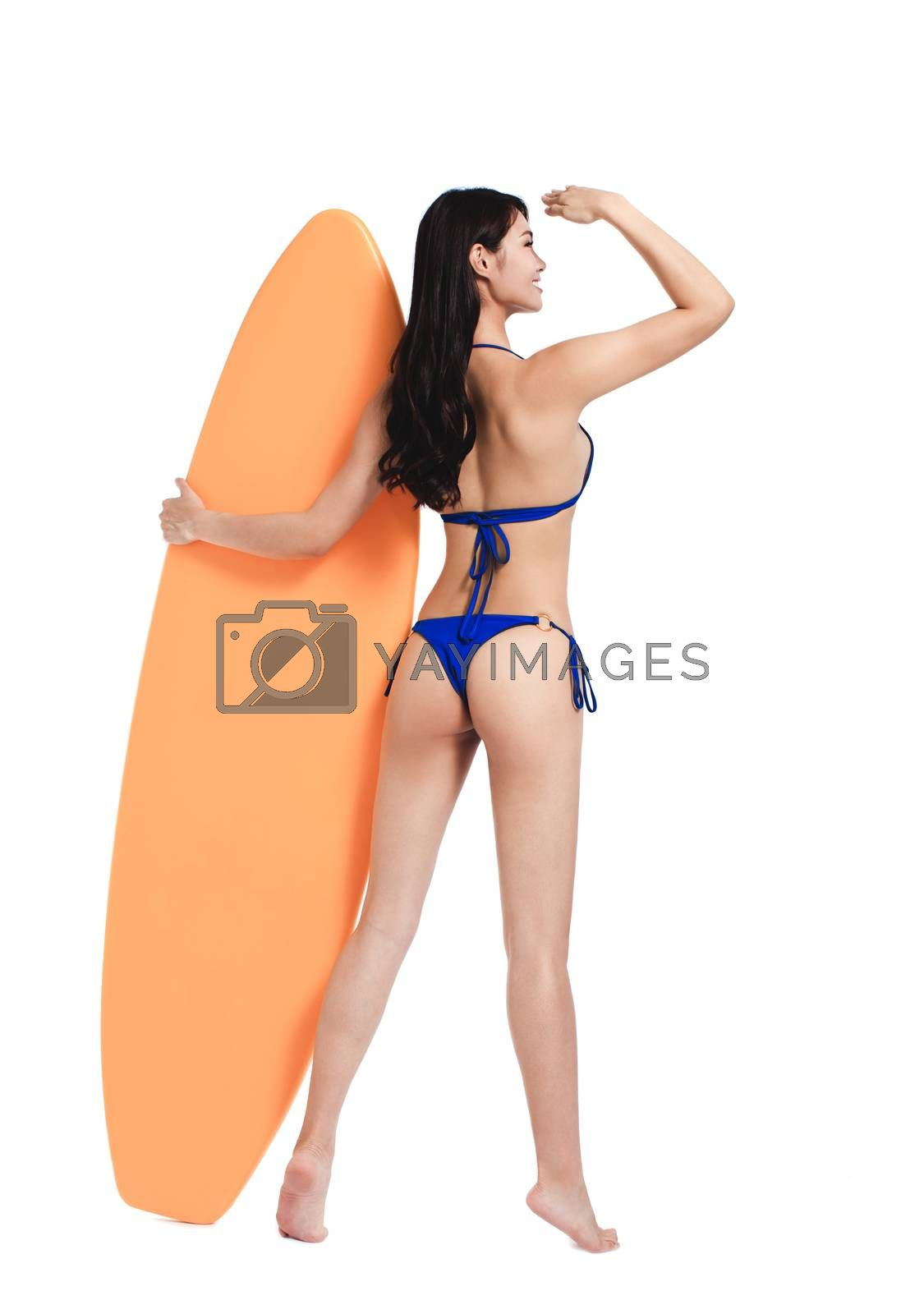 Rear view of Beautiful young woman in bikini and  standing with  surfboard