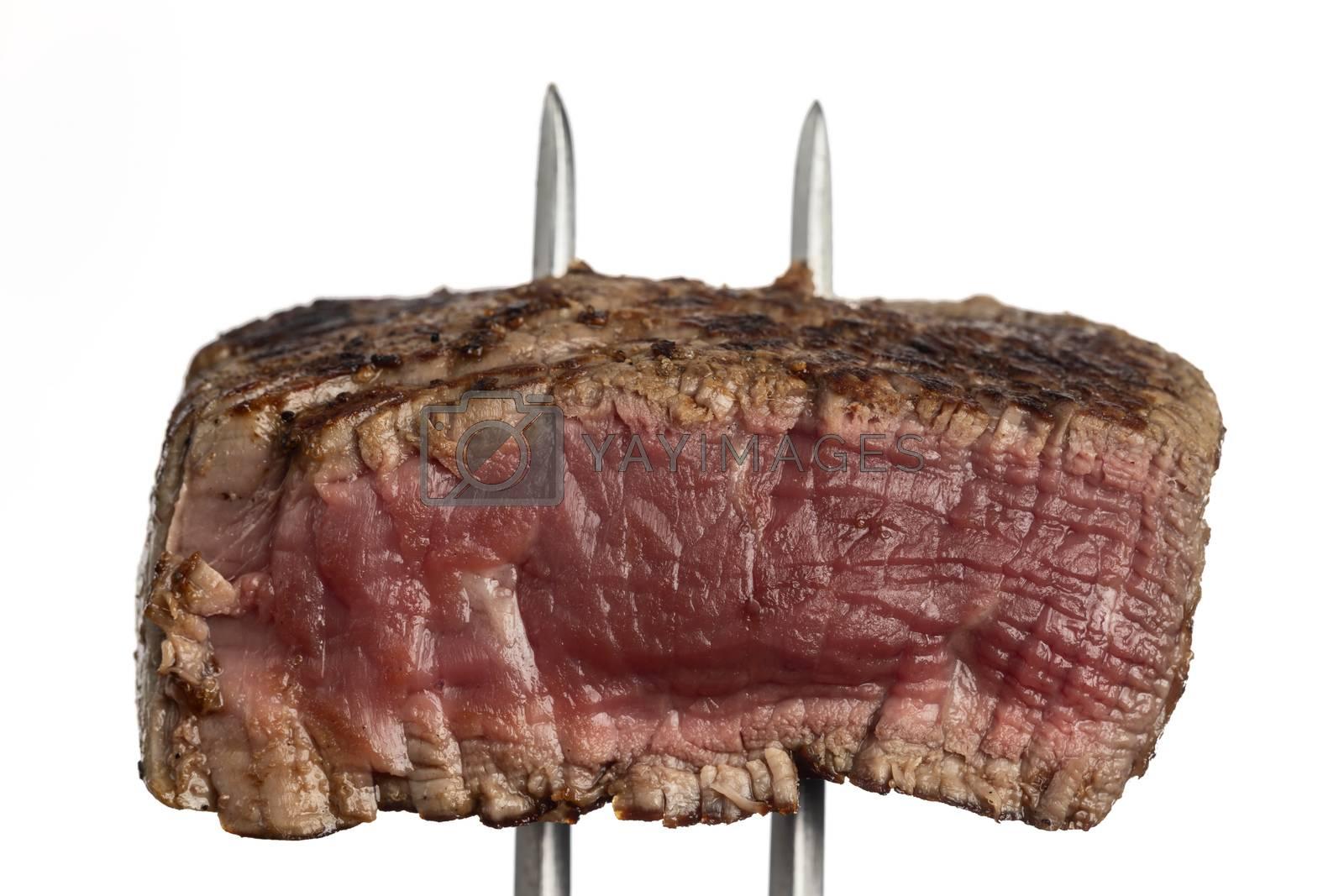 grilled steak on a meat fork