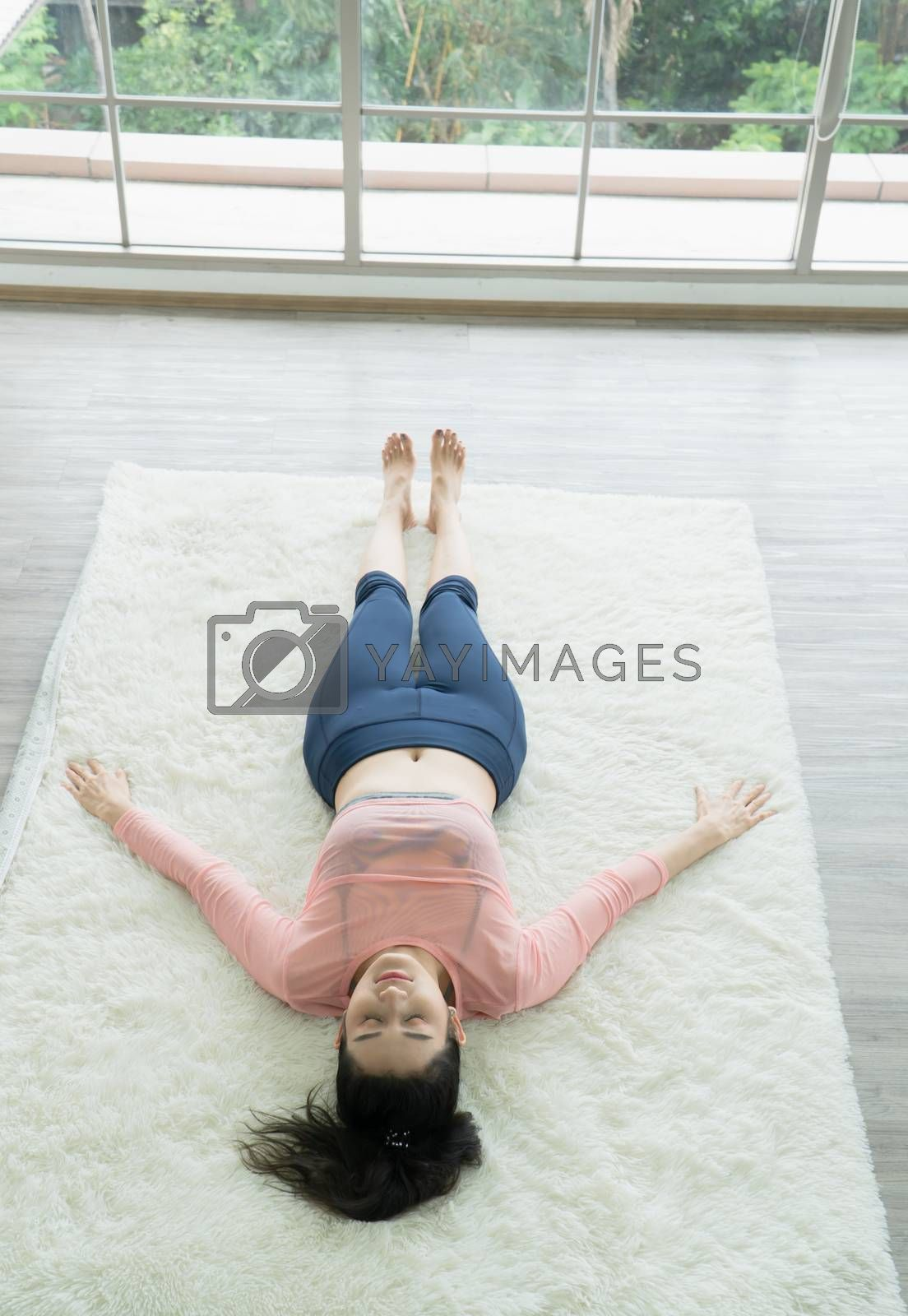 Attractive and healthy woman Asian are exercising Stretching with yoga postures at home helps to balance life.