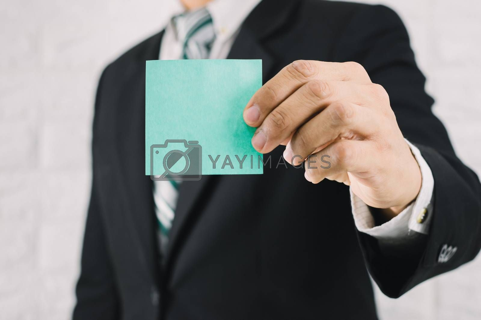 Business man holding card paper post-it notes