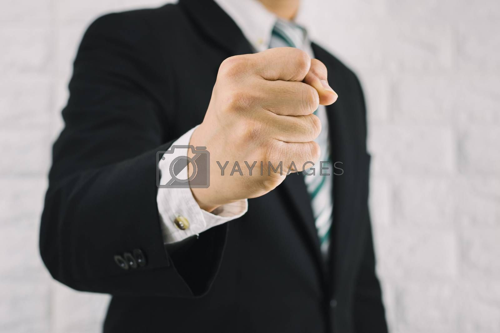 Business man fist handful of business successes