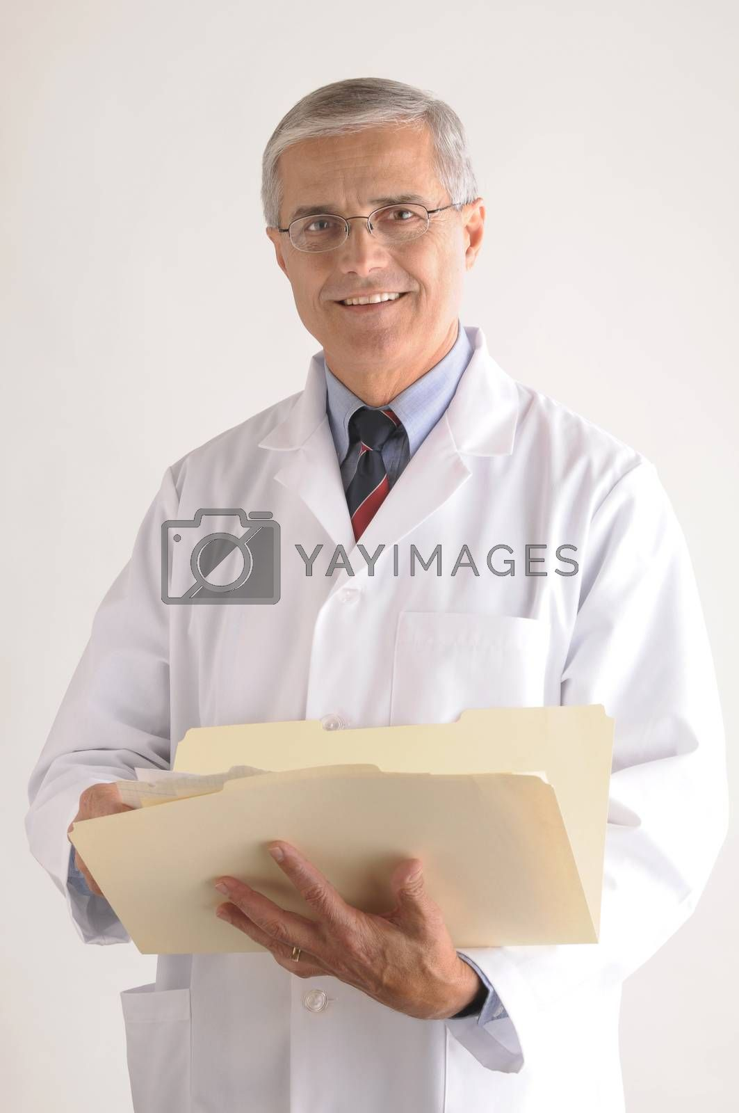 Middle Aged Doctor in Lab Coat Holding Folder with Patients Chart vertical format over gray background