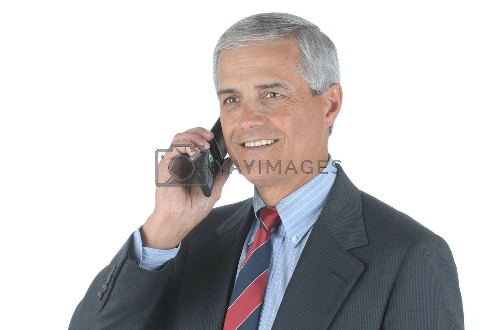 Close up of a smiling middle aged businessman talking on his cell phone isolated over white