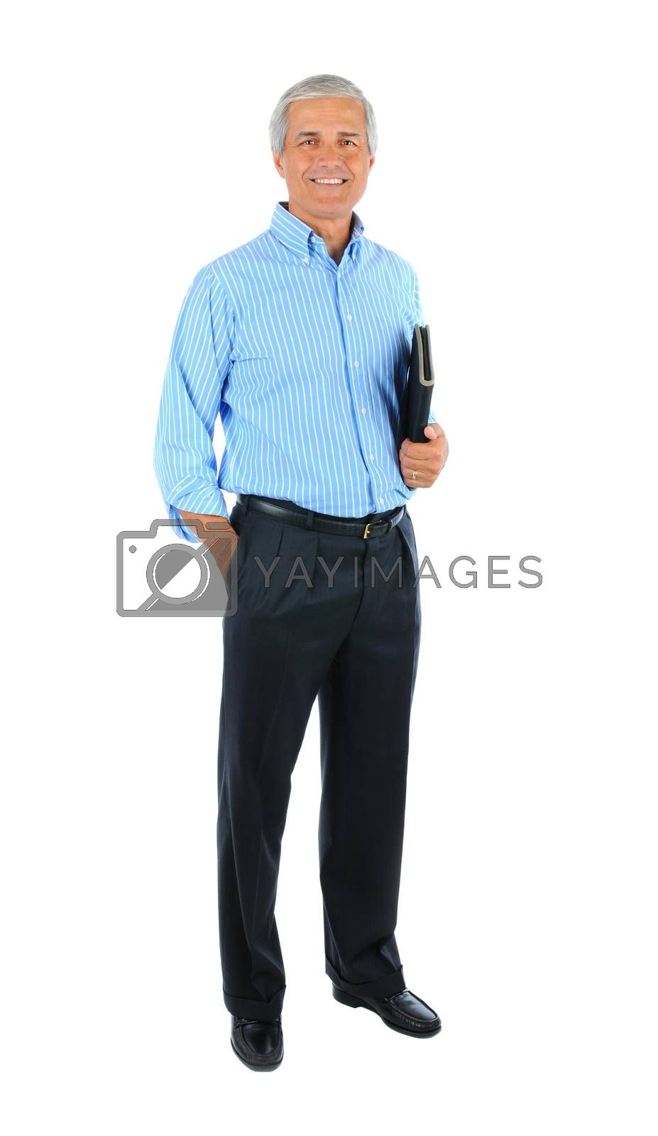 Middle aged businessman with one hand in pocket and a notebook under the other arm. Man is smiling and standing. Full length shot isolated over white