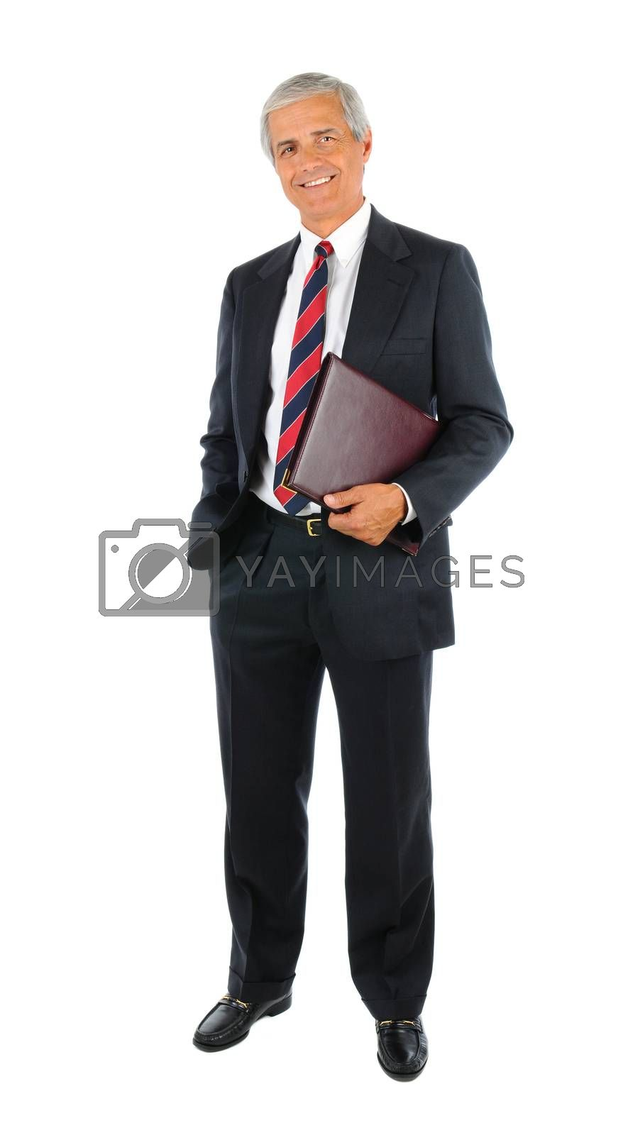 Smiling middle aged businessman in a suit and tie holding a leather portfolio. Full length over a white background.