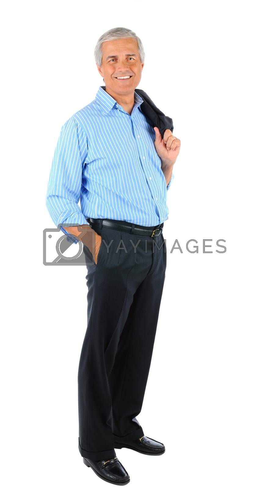 Smiling middle aged businessman standing holding his jacket over his shoulder and one hand in pocket. Full length over a white background.