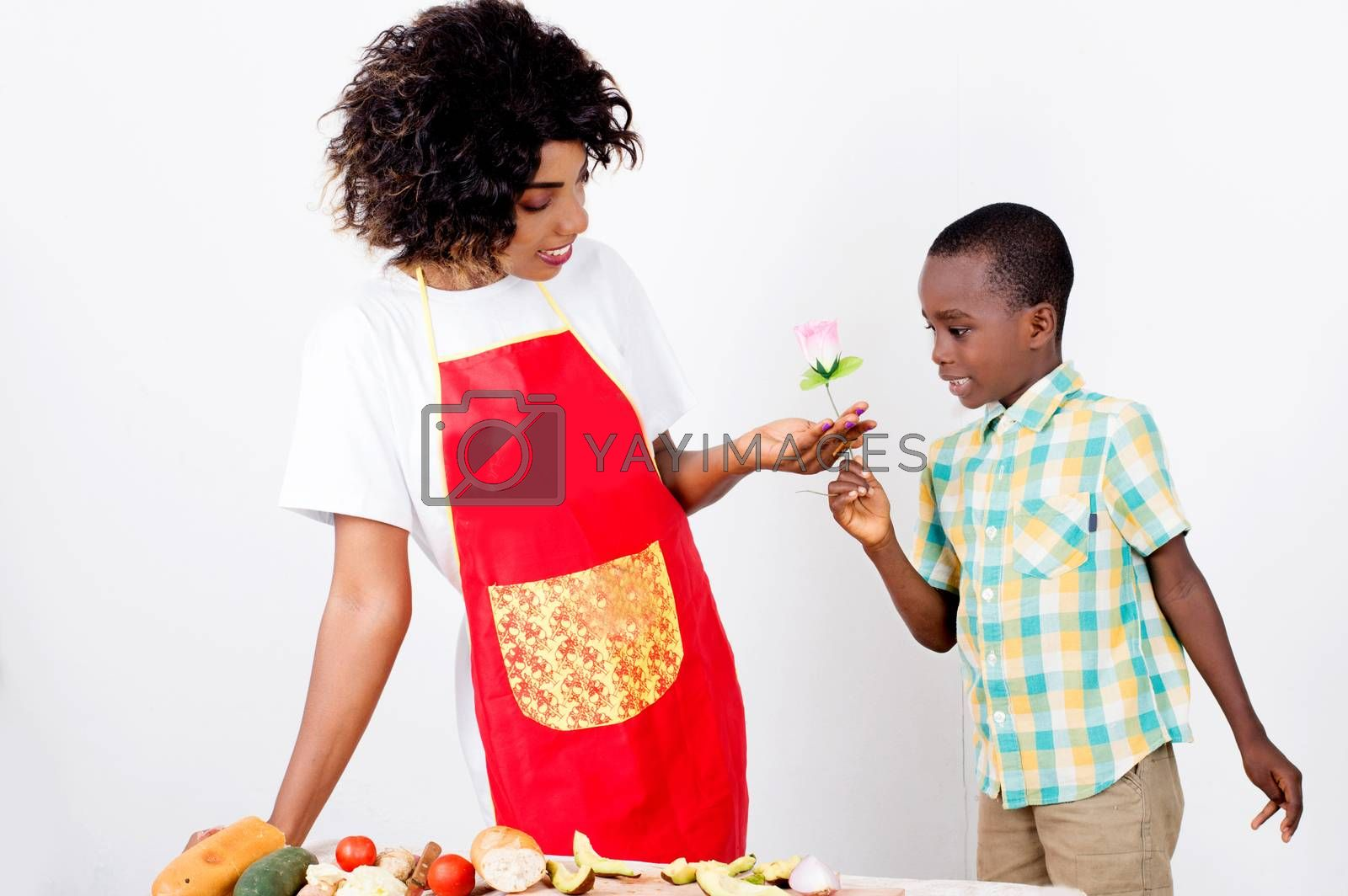 Little boy giving a flower to his mother on Mother's Day.