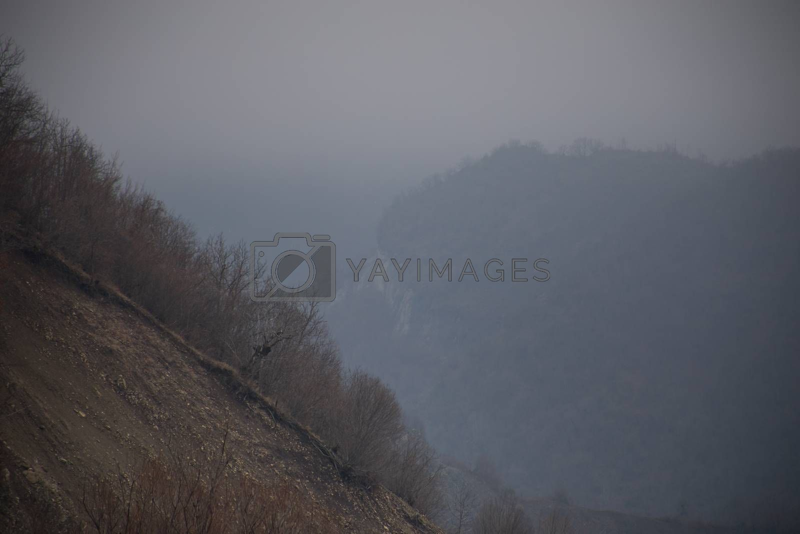 Panorama of the foggy winter landscape in the mountains with snow and rocks, Beautiful landscape of winter nature of Azerbaijan, Lahic, Big Caucasus