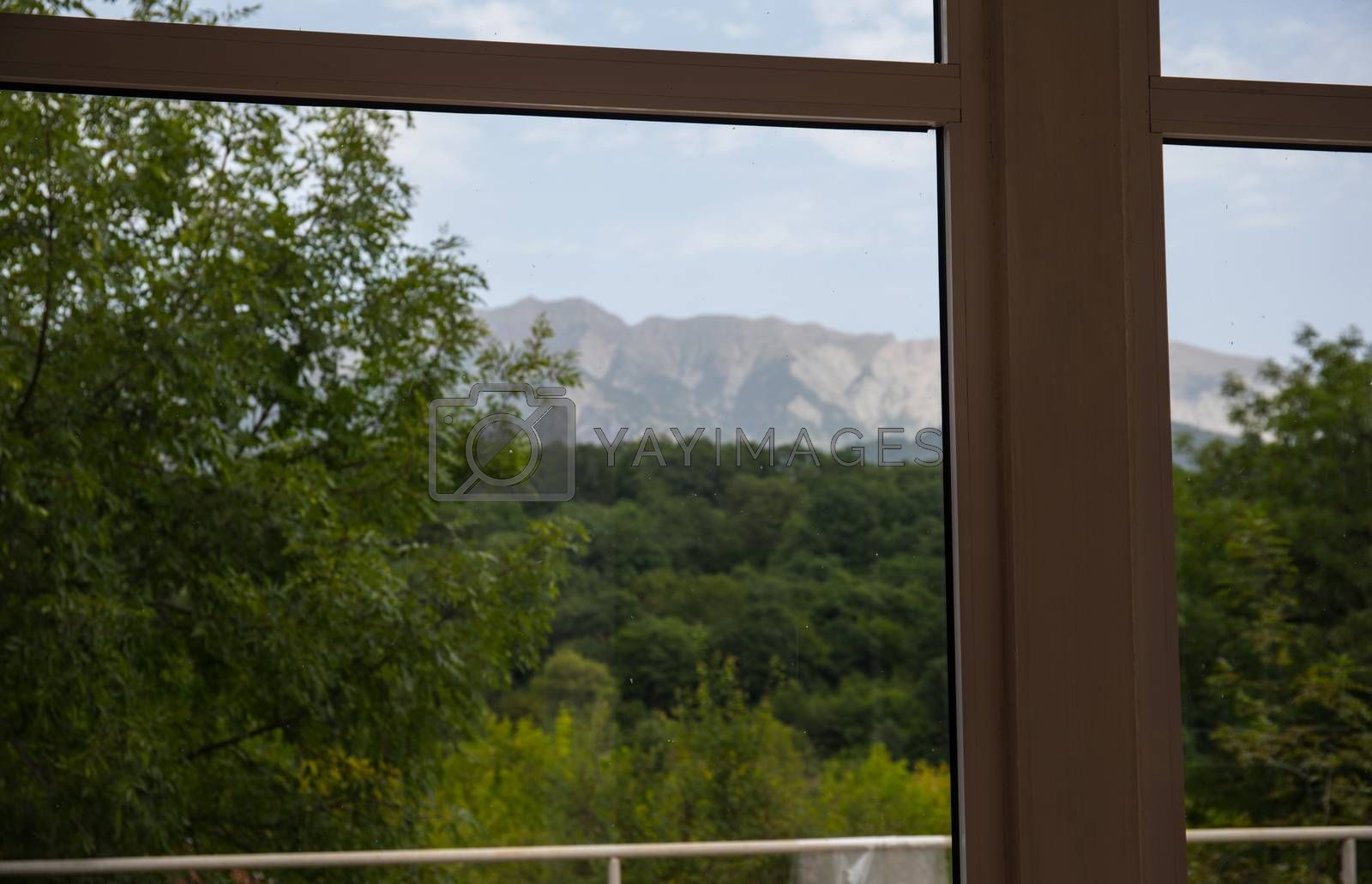 landscape nature view background. Mountains and forest view from window.
