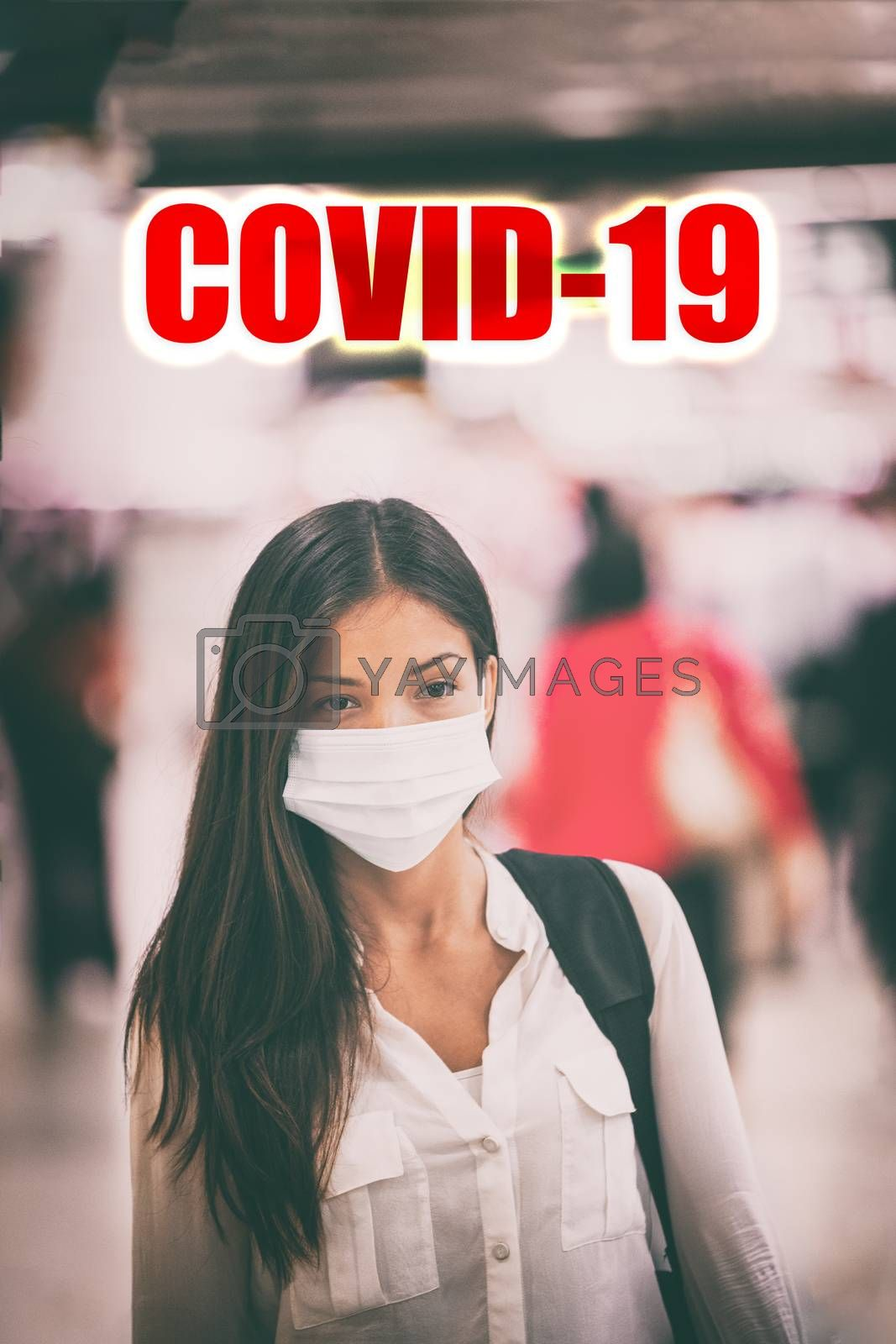 Coronavirus COVID-19 virus infection. Asian woman walking in airport crowd wearing virus surgical face mask with text title above. Vertical.