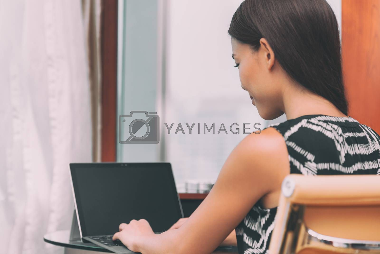 Working from home remote work freelance worker employee woman typing using laptop computer online communication for small business. Businesswoman at home office desk.