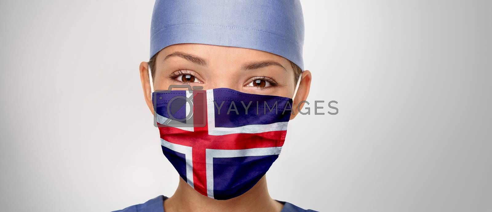 Icelandic flag Iceland COVID-19 panoramic banner Corona virus outbreak pandemic doctor woman wearing PPE protective face mask for coronavirus prevention. Asian nurse happy. Health care worker helping by Maridav