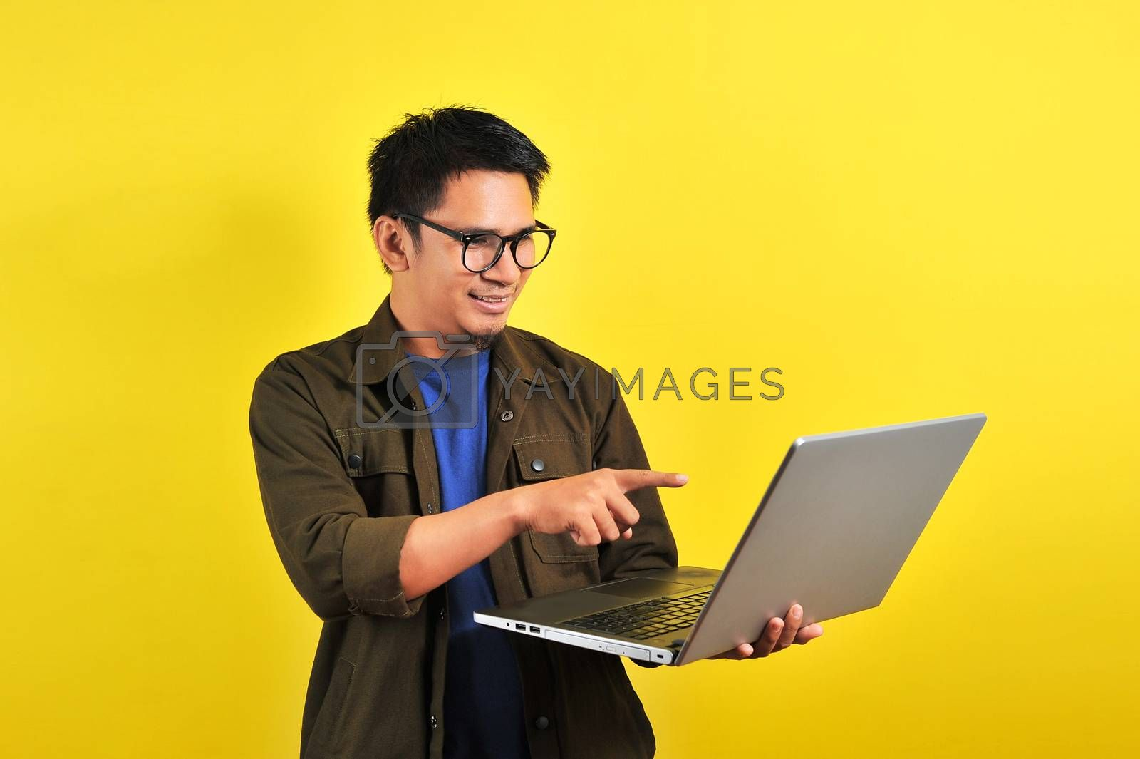 Royalty free image of Smiling pleased handsome asian young male entrepreneur by heruan1507