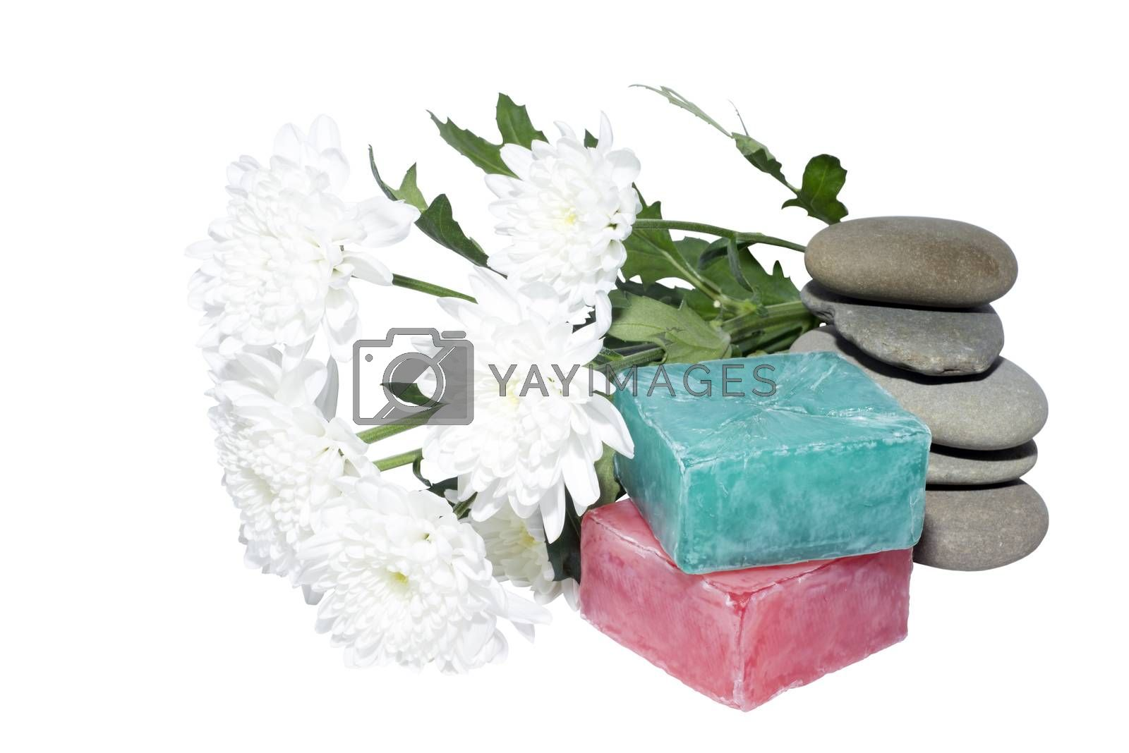 soaps off various shades with grey sone pebbles and flowers