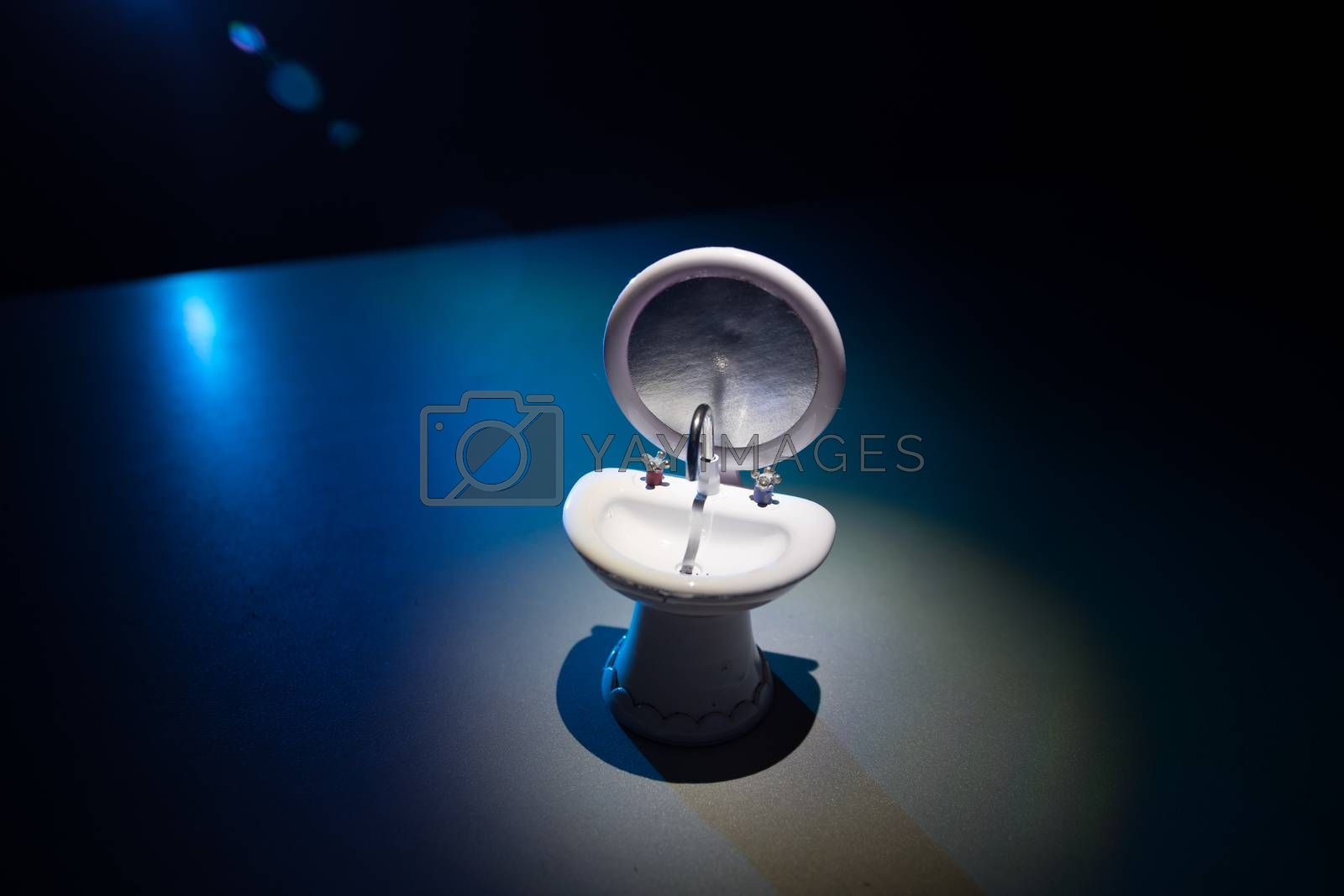 Miniature washstand on dark background. Hygiene concept. Wash hands protect yourself. Corona virus Prevention. Selective focus