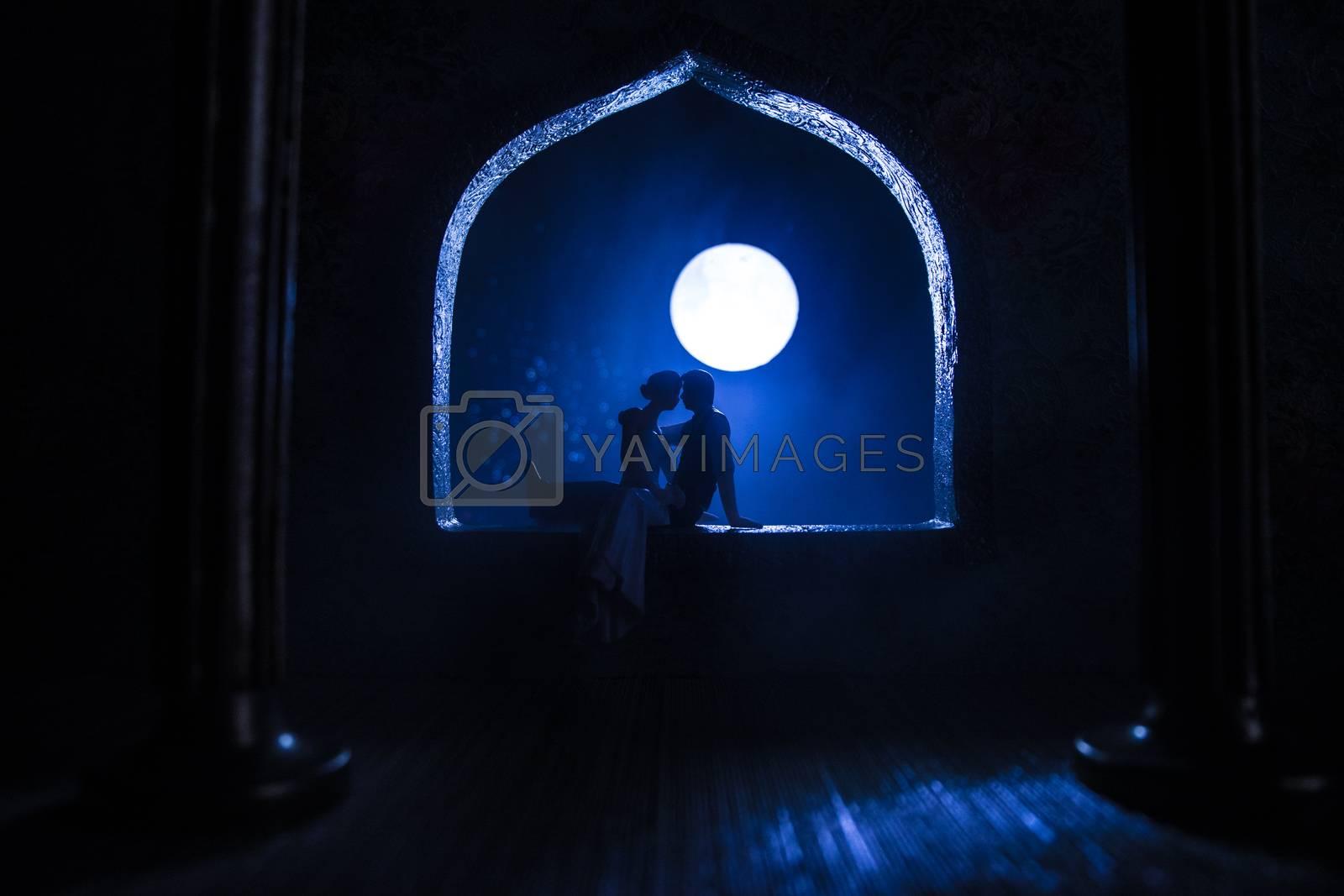 Beautiful arabian interior realistic miniature. Table decoration. Romantic couple at window. Selective focus