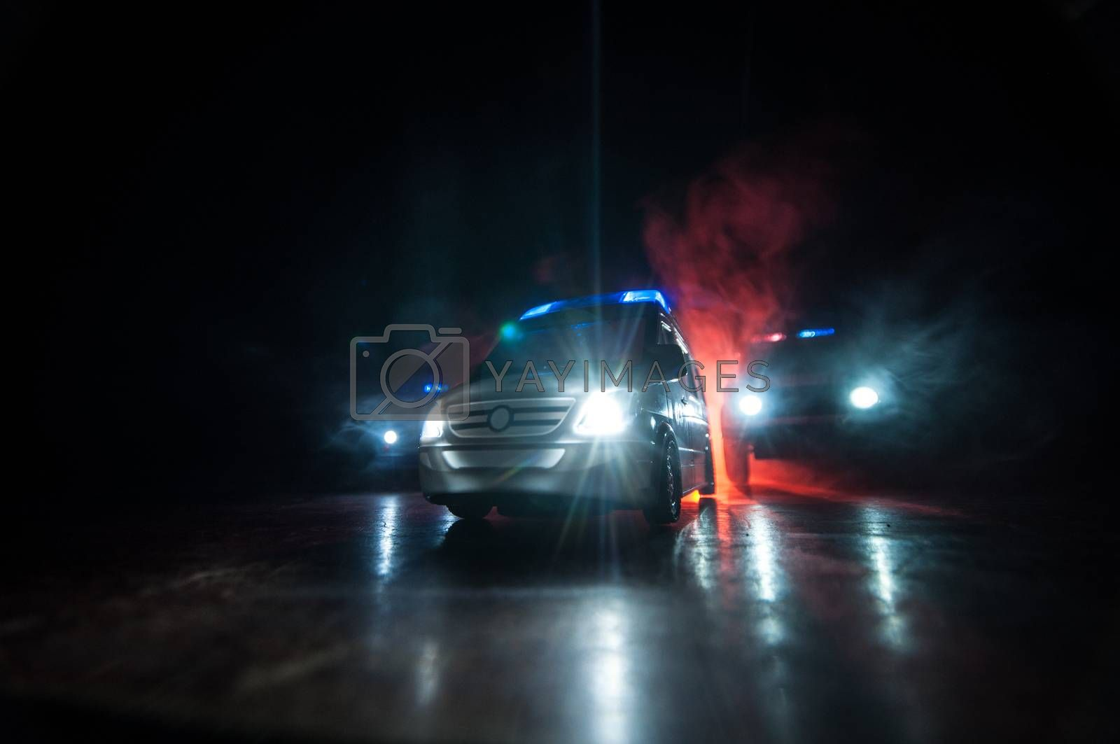 Corona virus concept with Ambulance car. Stay home for precautionary measures to prevent from corona virus. Ambulance car on dark misty background. Creative artwork decoration. Selective focus