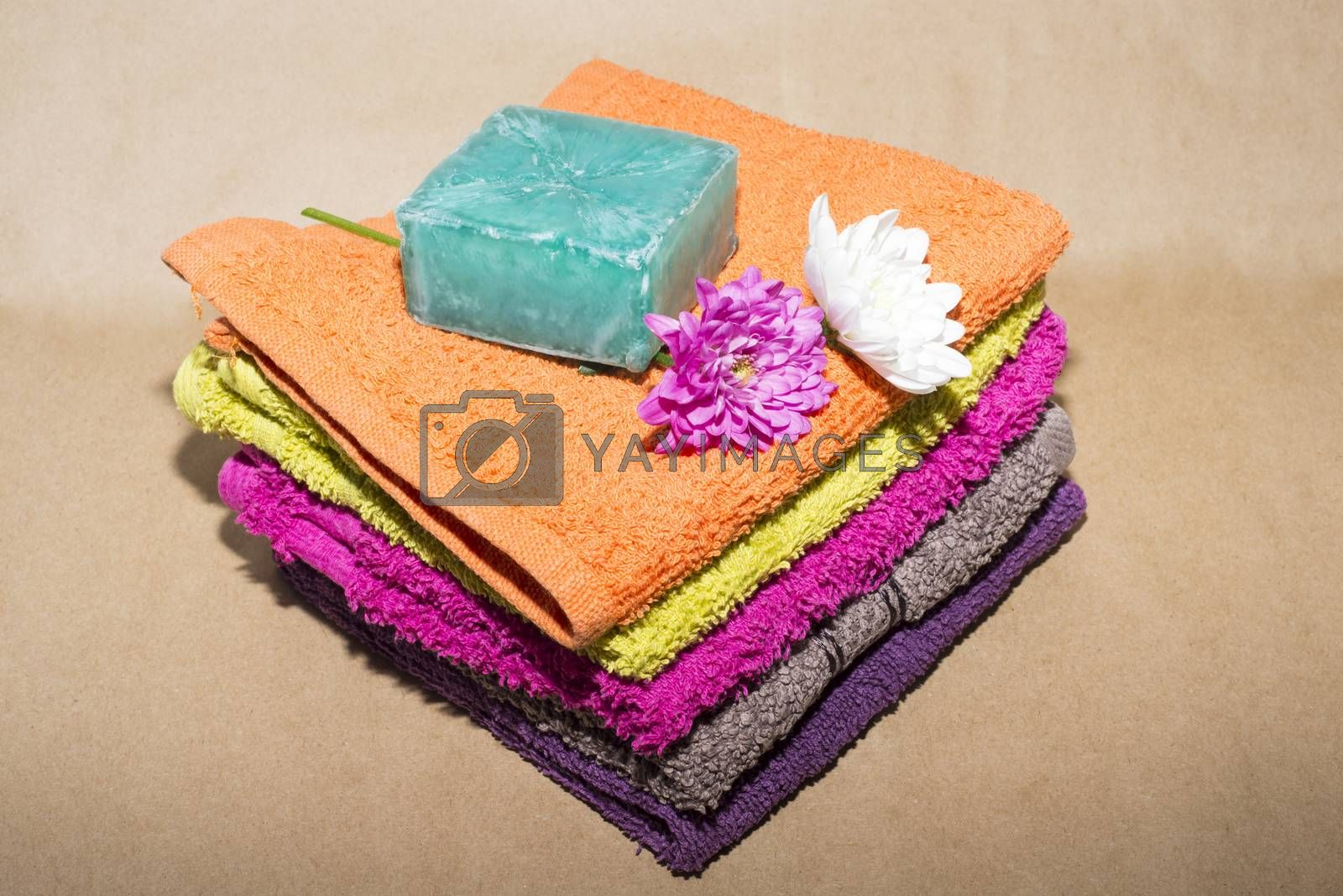 soap bar on top of facecloths off various shades with flowers