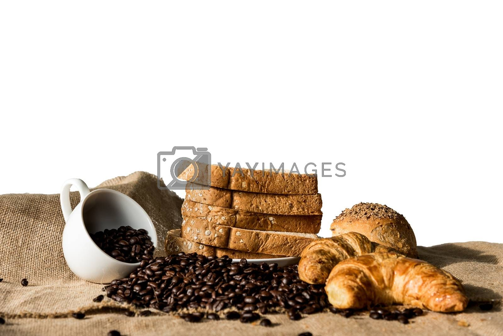 Bread and Croissant on the sackcloth with empty coffee cup and coffee beans.