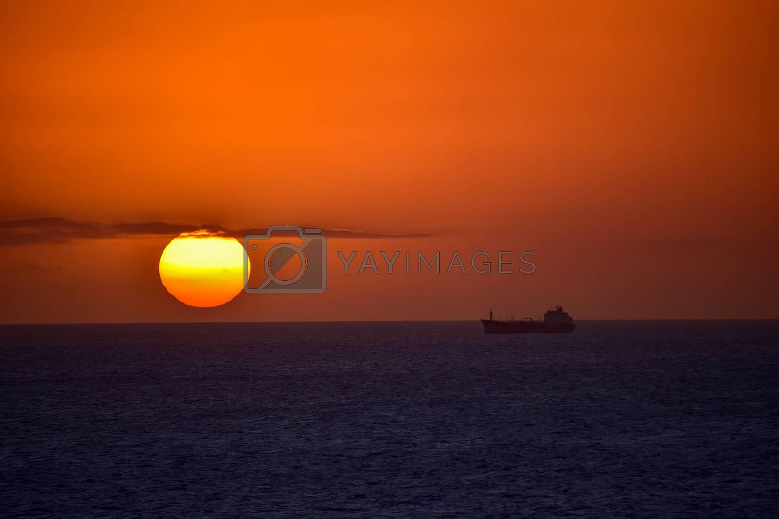 Aruba - December 2014: Container ship on the horizon at sunset