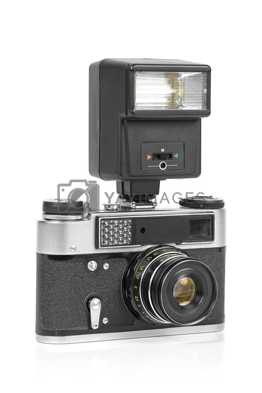 Royalty free image of Vintage analog camera with manual flash light by mkos83