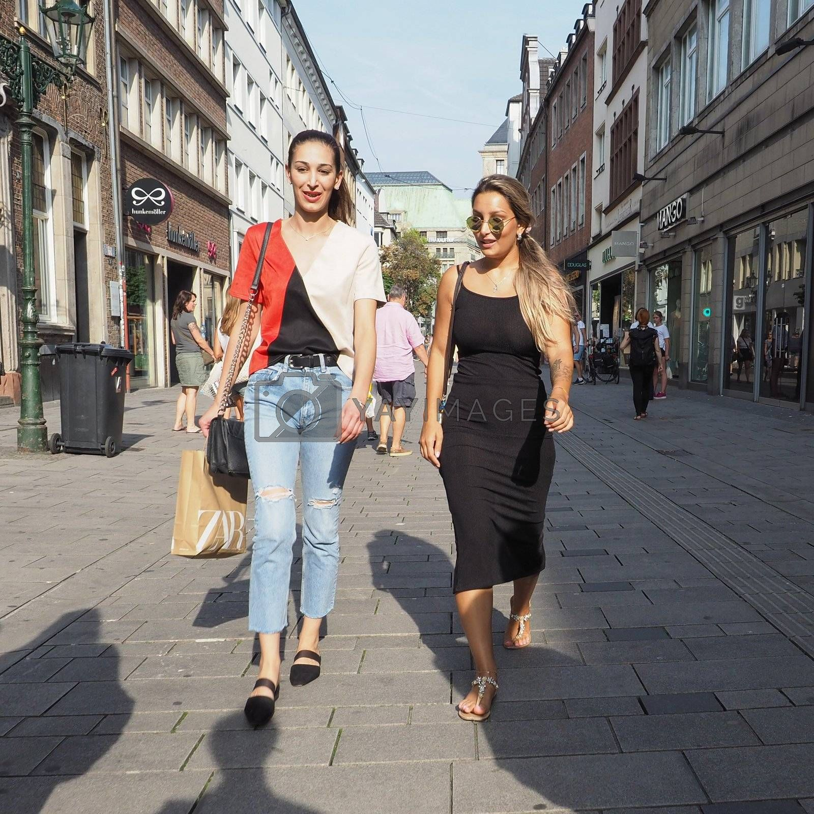 DUESSELDORF, GERMANY - CIRCA AUGUST 2019: People in the city centre