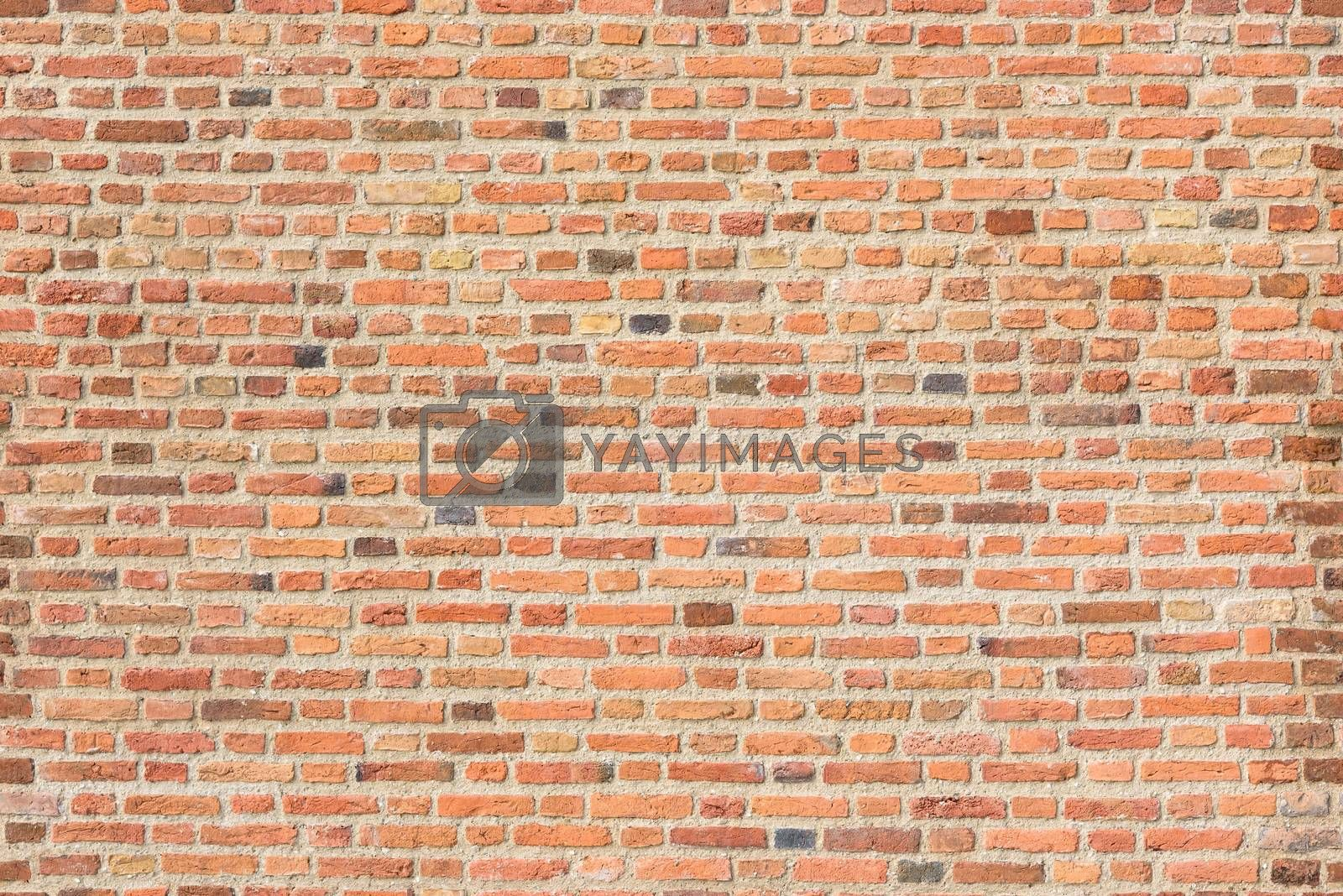 Old red brick wall as seamless texture or background