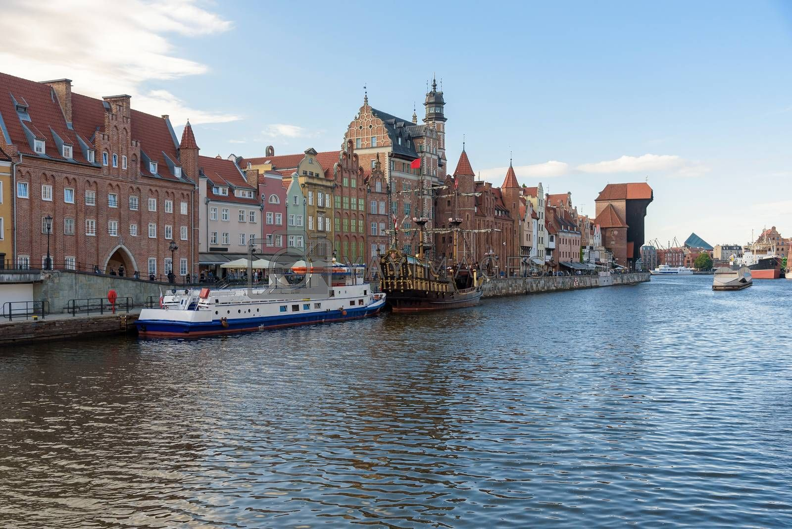 Passenger ships moored in pier at Motlawa river in Gdansk old town, Poland