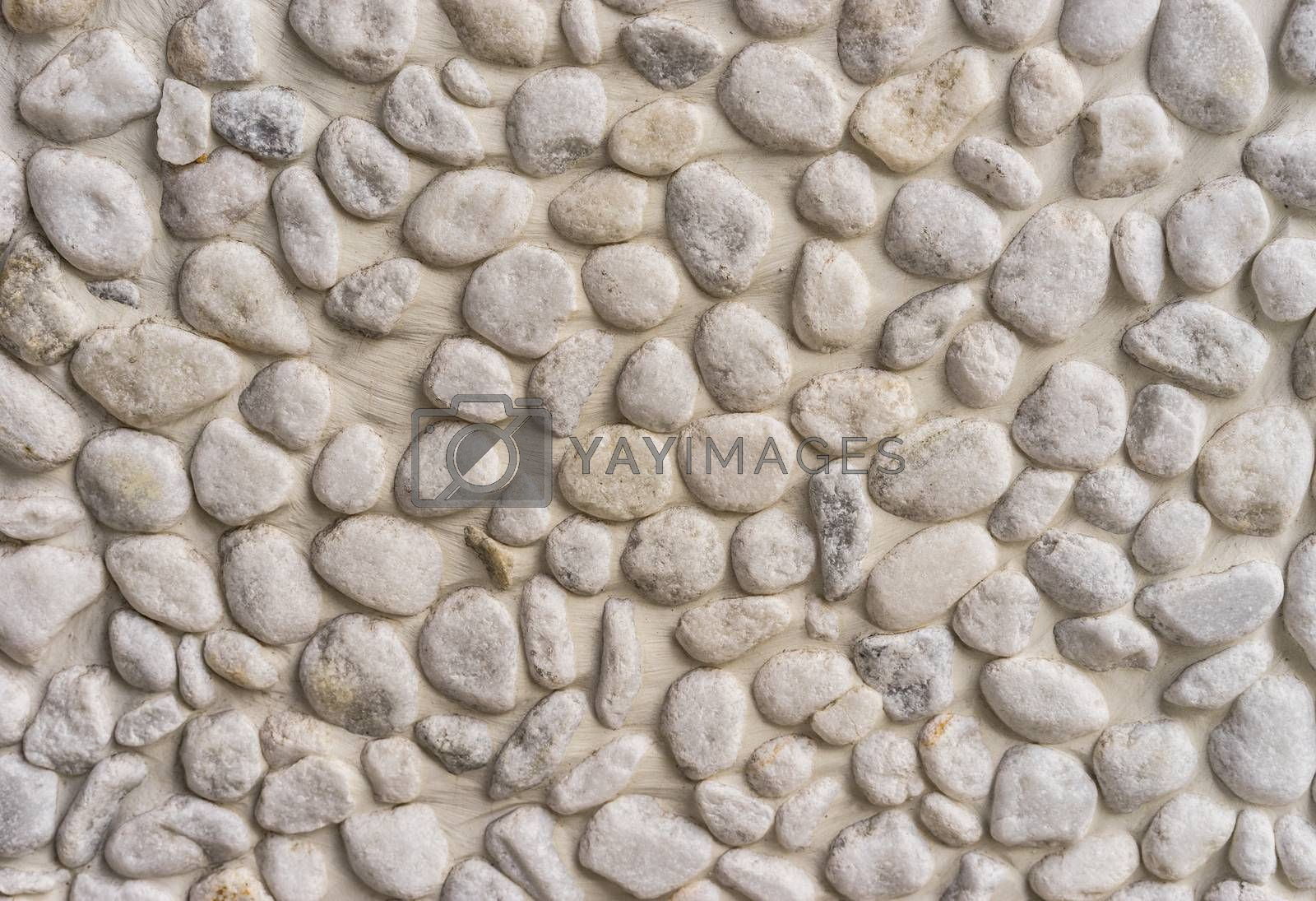 Close-up of gray and white pepples stones background texture
