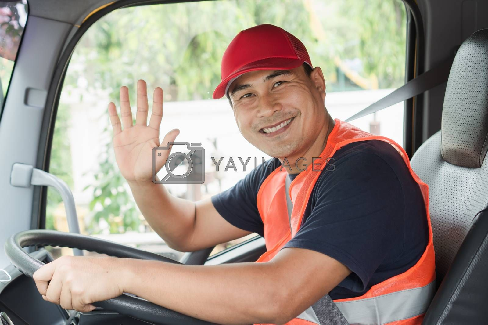 Professional worker truck driver, confident middle-aged Asian man wearing safety clothing Smile proudly In moving forward For a long transportation business
