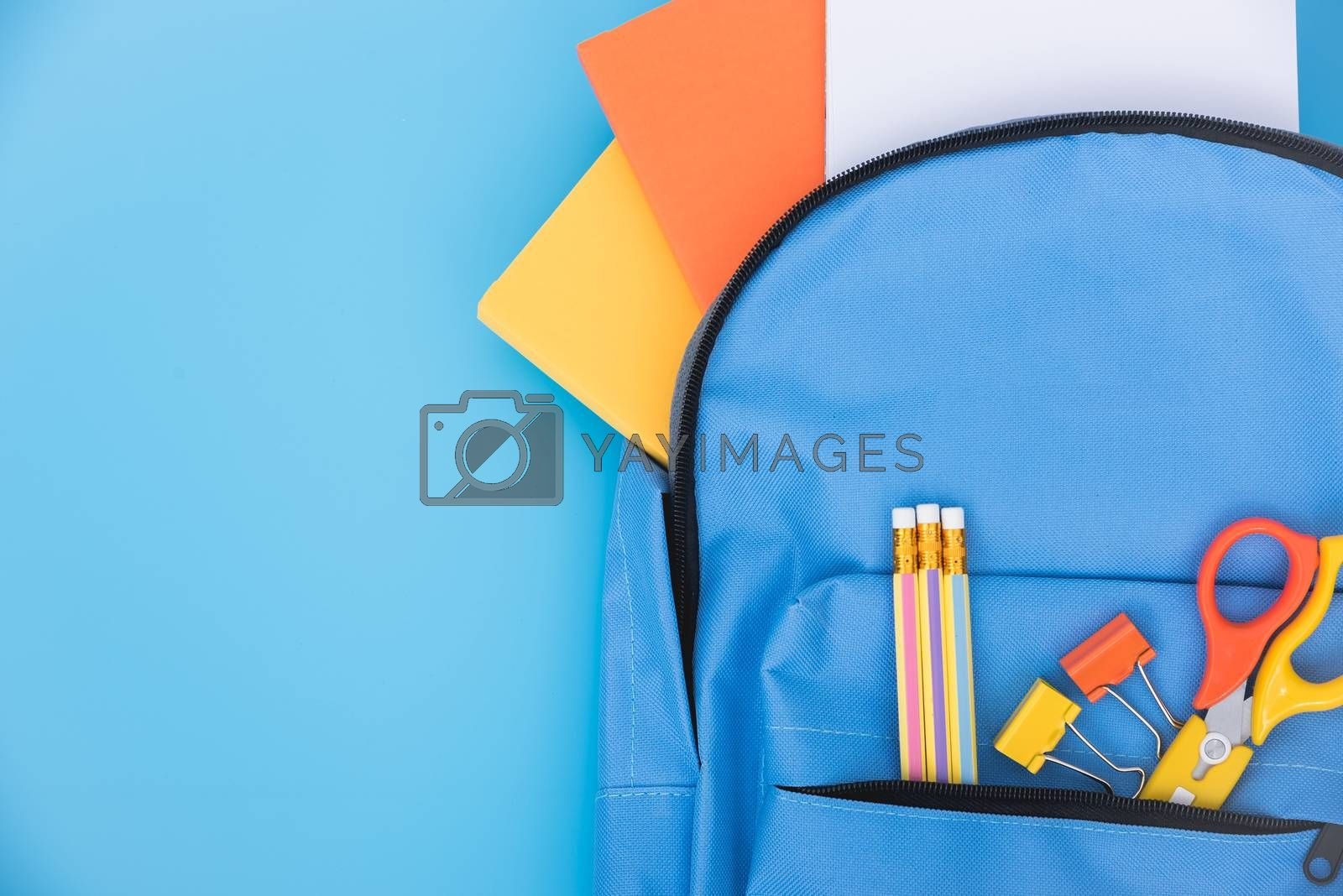 Top view flat lay of blue school bag backpack and accessories tools for children education on blue background, Back to school concept and have copy space for use