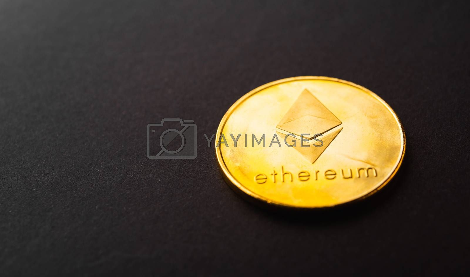 Golden ether coins or Ethereum network exchange on black background, blockchain and money cryptocurrency (crypto currency) concept