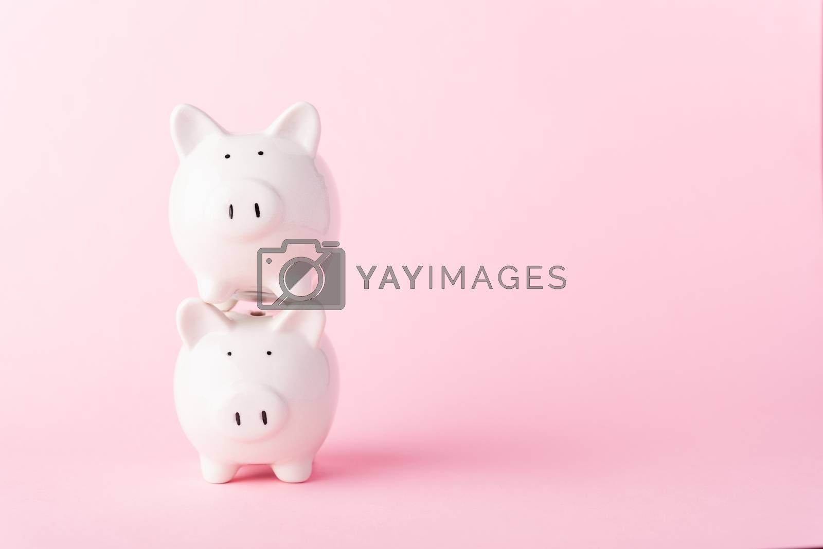 International Friendship Day, Front stack two small white fat piggy bank, studio shot isolated on pink background and copy space for use, Finance, deposit saving money concept