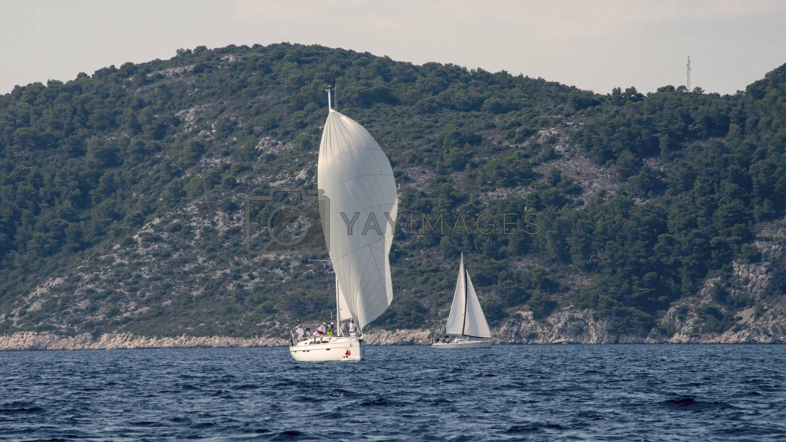 Croatia, Hvar - June 2018: Sailing boats in the waters around the hills at Hvar Old town