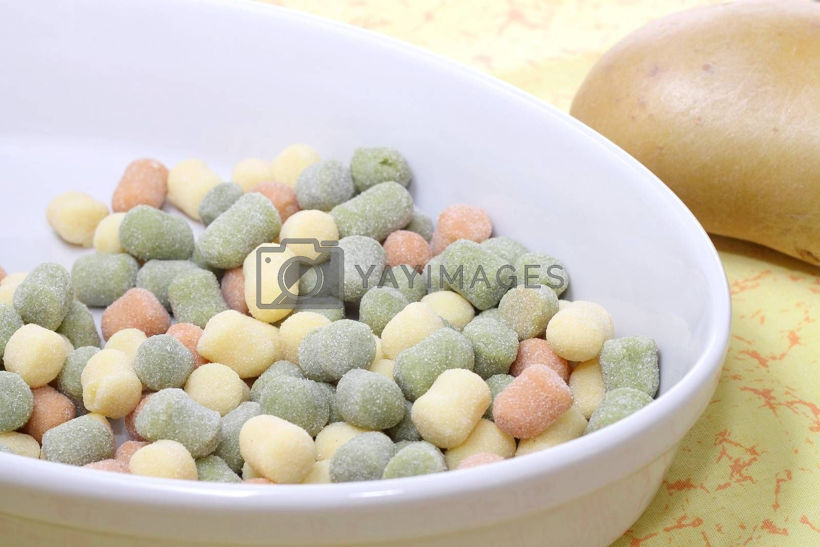 Italian gnocchi with basil leaves and potato