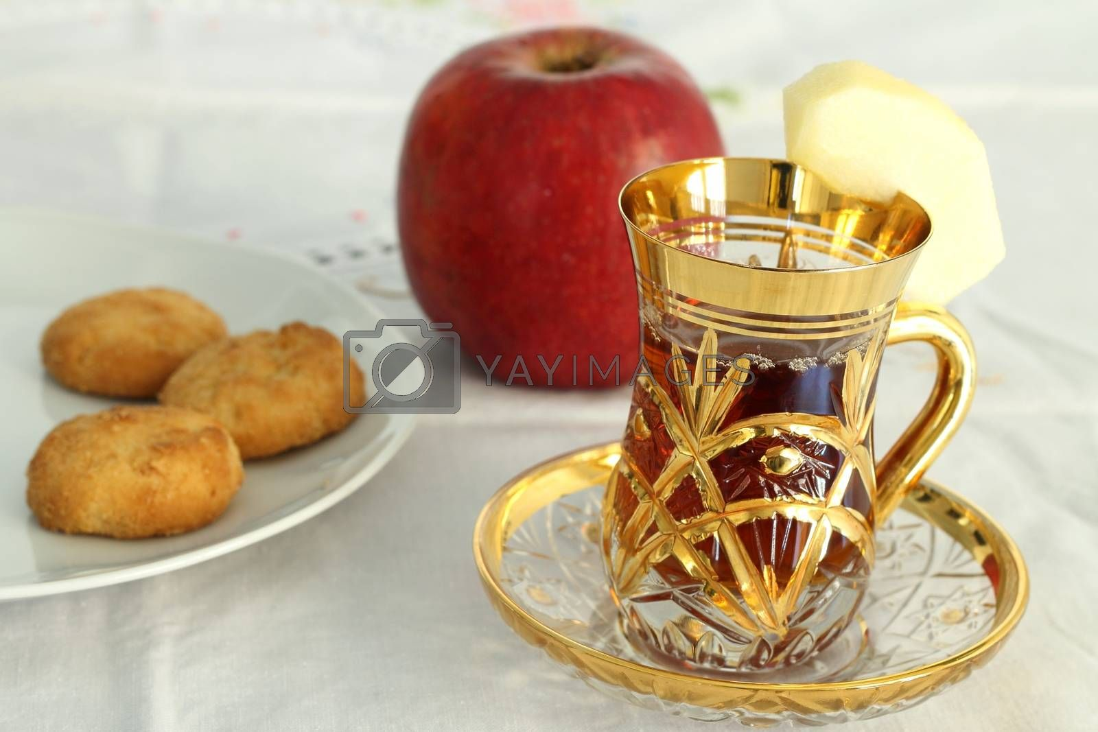 Cup of apple tea with biscuits
