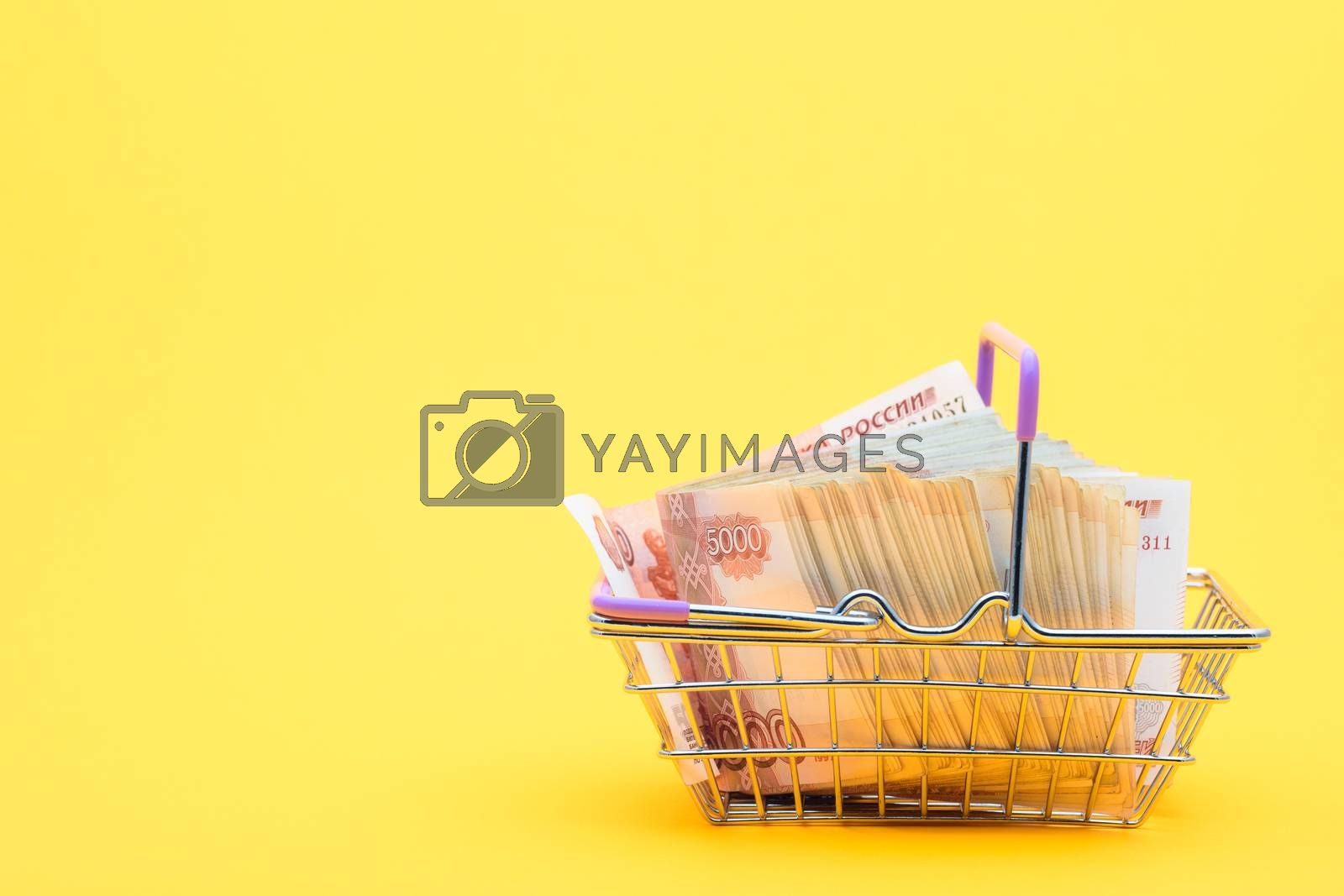 A grocery basket full of five thousandth bills