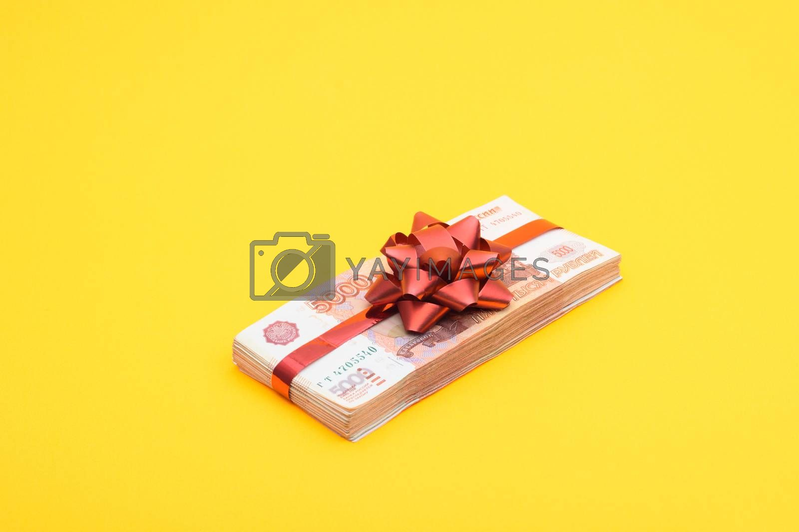 Gift pack of five thousandth Russian bills on a yellow background