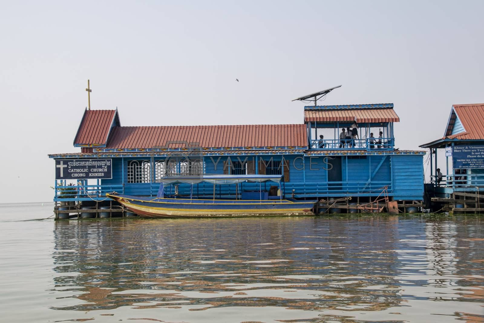 Cambodia, Tonle Sap Floating Village - March 2016: Children playing on the deck of this floating Church which doubles as a school house