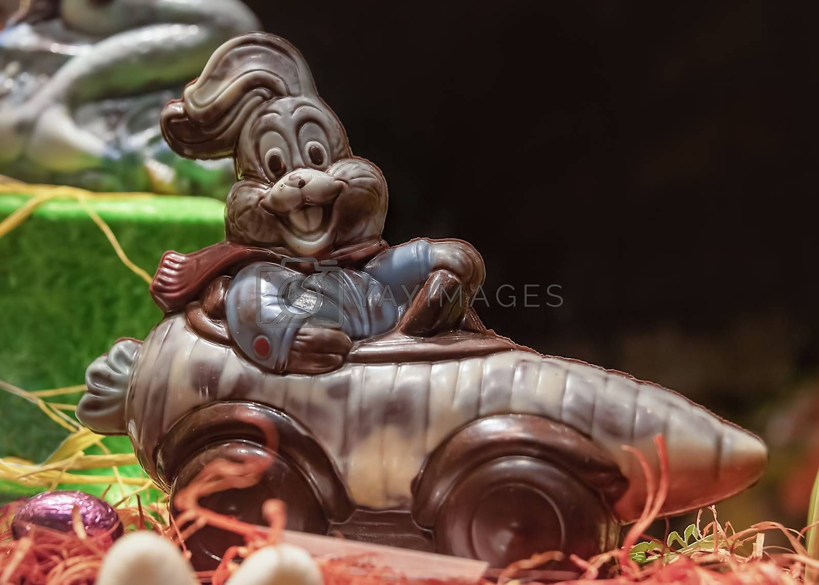 France, Strasbourg - May 2018: Chocolate Easter bunny - driving a carrot shaped car