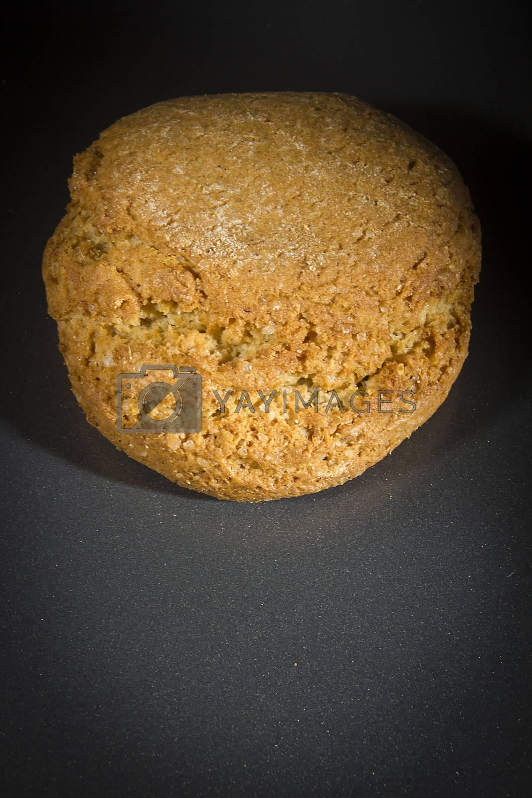 Crispy oatmeal cookies on a black background
