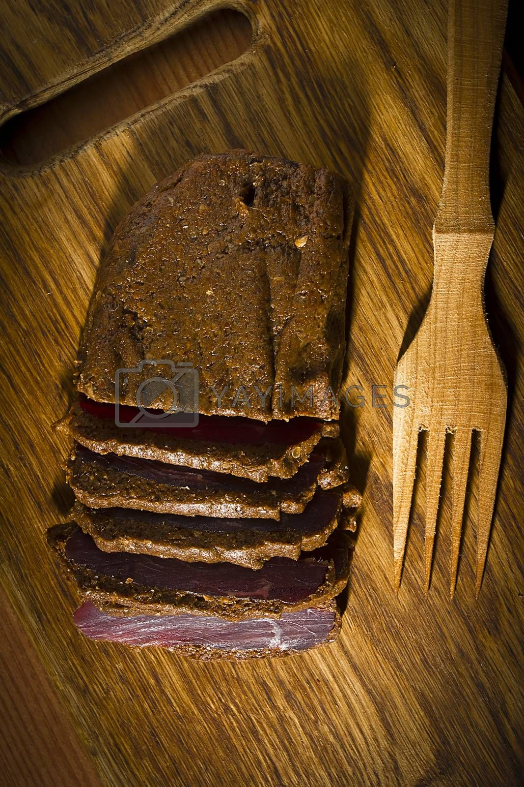 Cured meat on a wooden cutting board