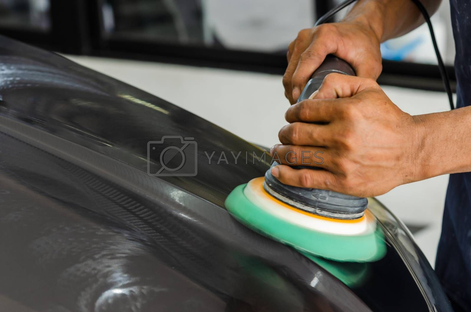 Man hands holding the work tool polish the car.Buffing and polishing car. Car detailing.