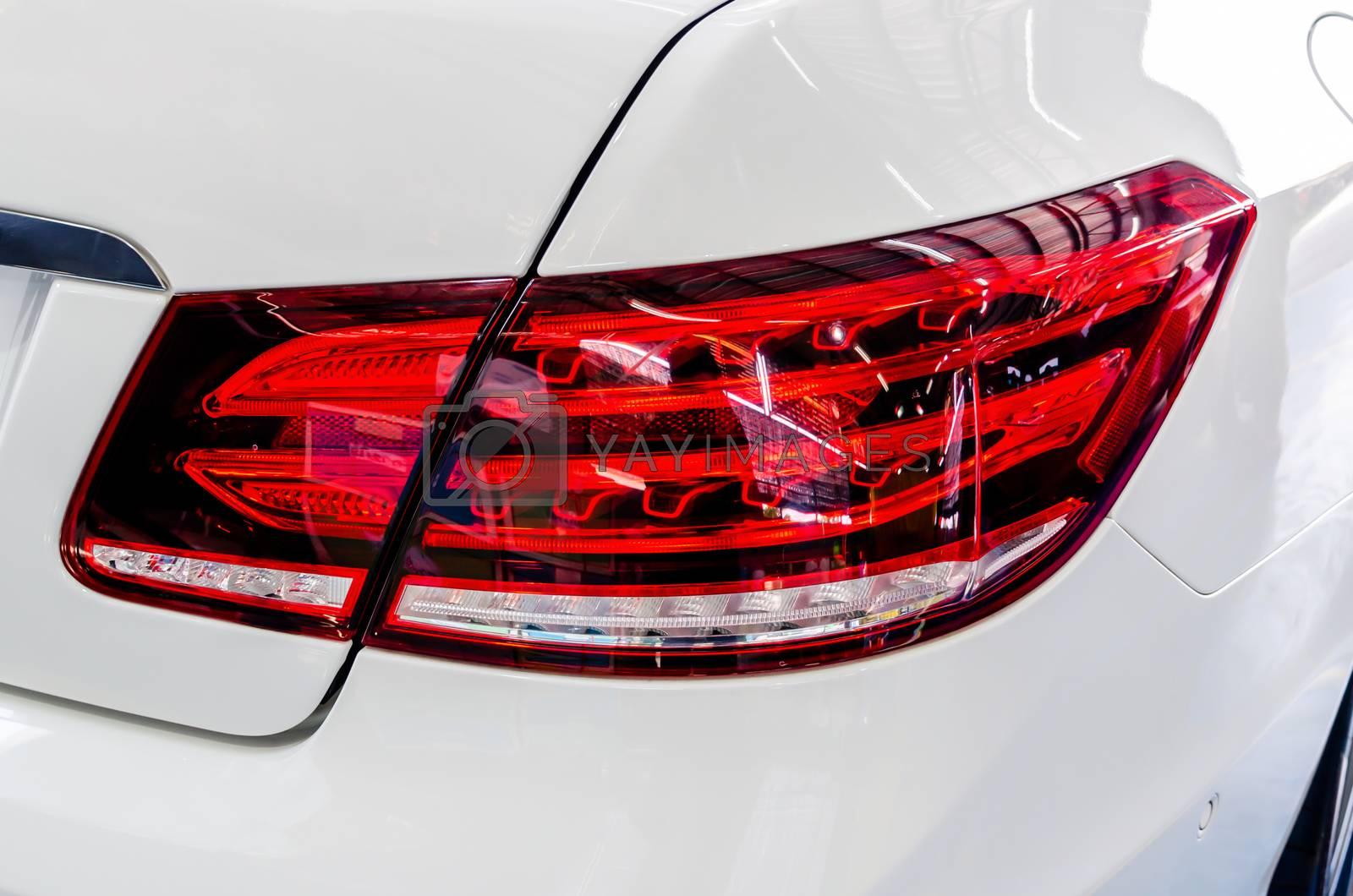 Car details - White luxury car tail lights.Modern LED light, white car rear.
