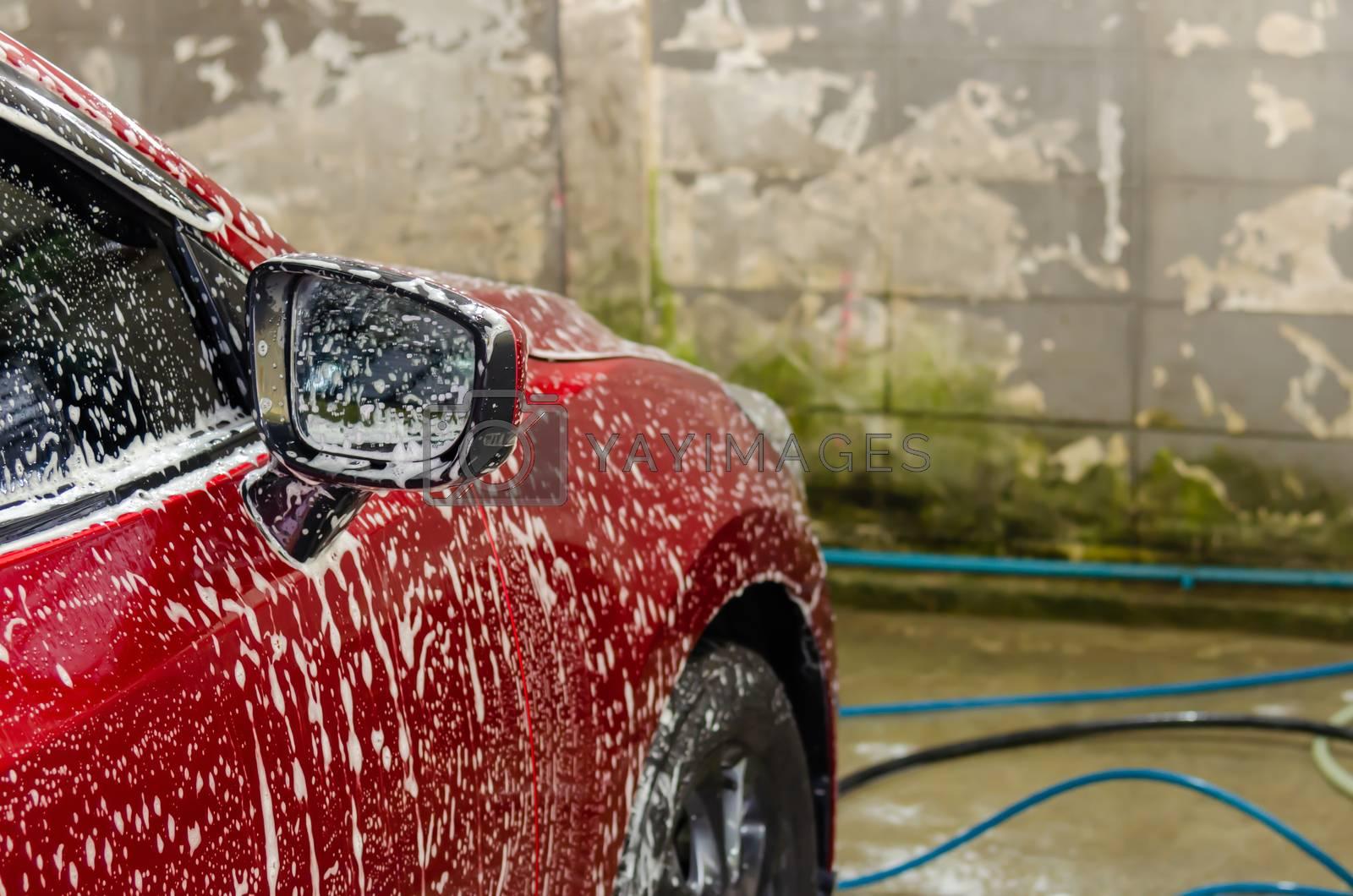 Car wash with foam bubbles.
