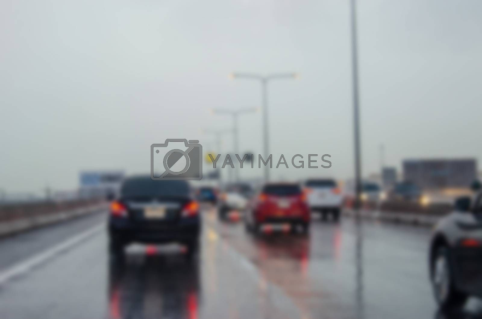 Blurred background traffic on the road when it rains.