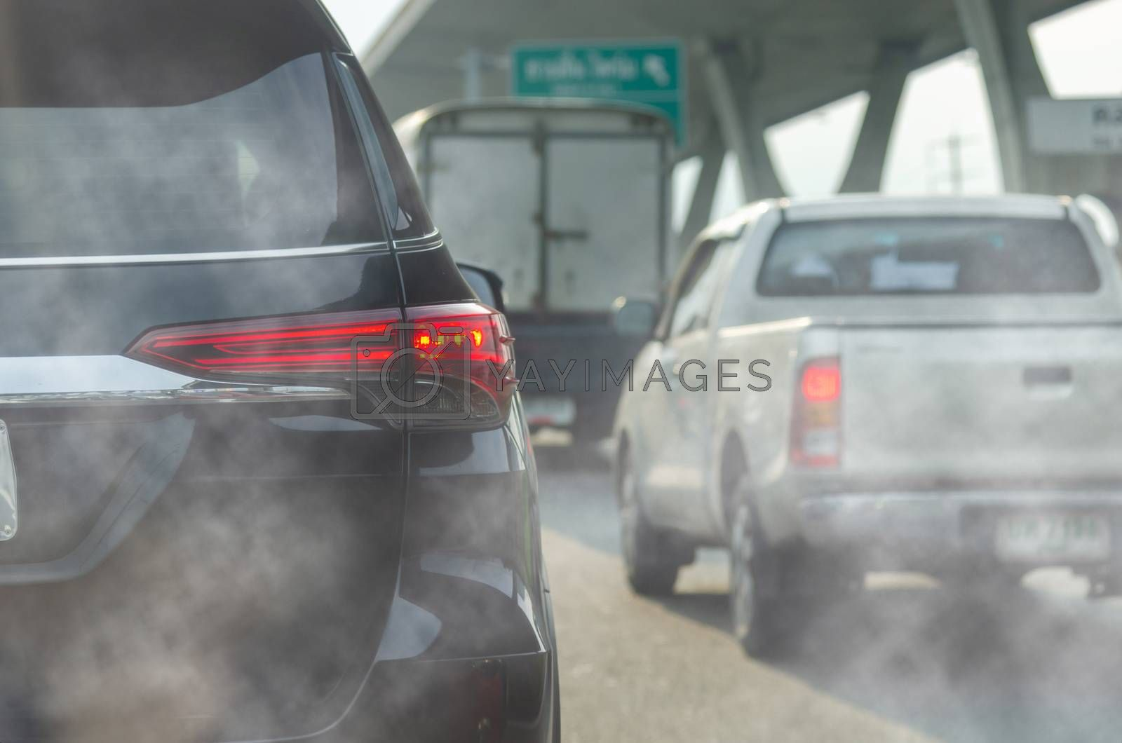 Pollution from vehicle exhaust in the city. Traffic jam on the road
